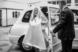 Bride arrival in car at Shepperton Studios