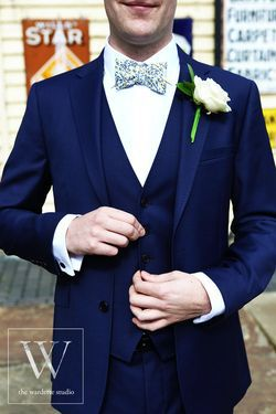 The Groom in blue suit