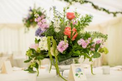 Flowers and greenery table centrepiece