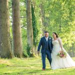 Bride and Groom laughing amongst the trees