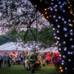 Wedding summer marquee at dusk