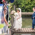 Bride and Groom boarding boat Marlow