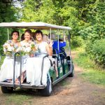 Bridesmaids on golf buggy